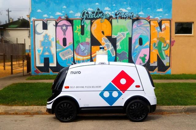 domino s and nuro are launching autonomous pizza delivery in houston beginning this week photo afp