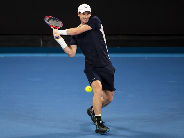 Andy Murray of Great Britain hits a backhand in his first round match against Roberto Bautista Agut of Spain during day one of the 2019 Australian Open at Melbourne Park on January 14, 2019 in Melbourne, Australia. PHOTO: GETTY