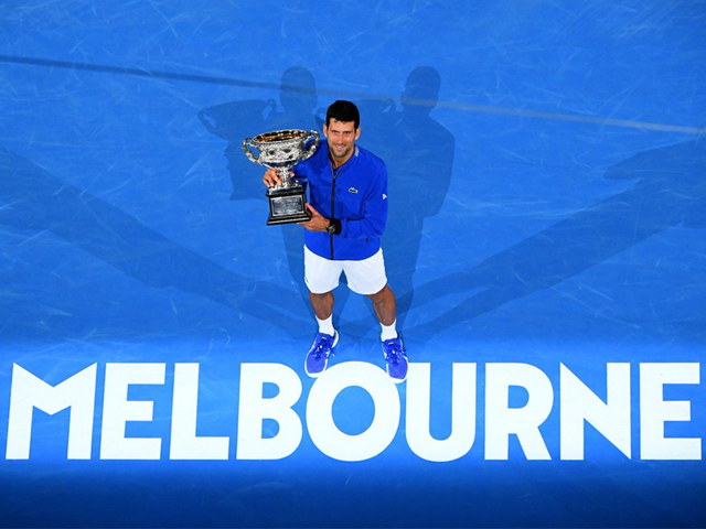 Novak Djokovic of Serbia poses with the Norman Brookes Challenge Cup following victory in his Men's Singles Final match against Rafael Nadal of Spain during day 14 of the 2019 Australian Open on January 27, 2019 in Melbourne, Australia. PHOTO: GETTY