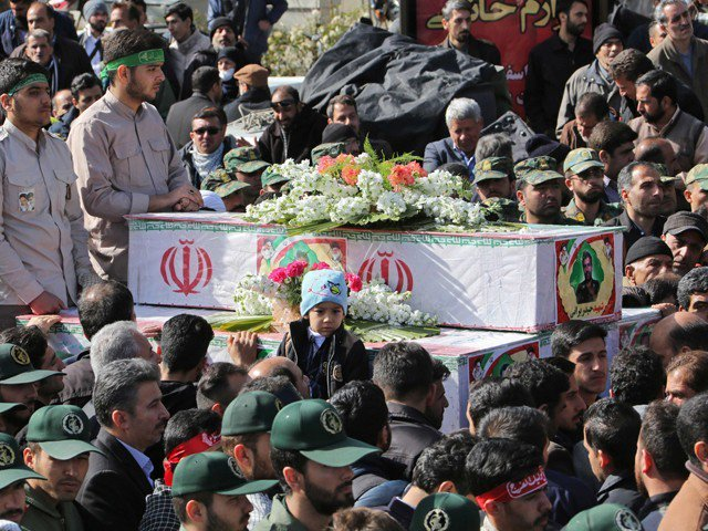 Members of Iranian revolutionary guards corps (IRGC) attend the funeral of fellow guards, who were killed in a suicide attack, in southeastern city of Isfahan on February 16, 2019. PHOTO: AFP