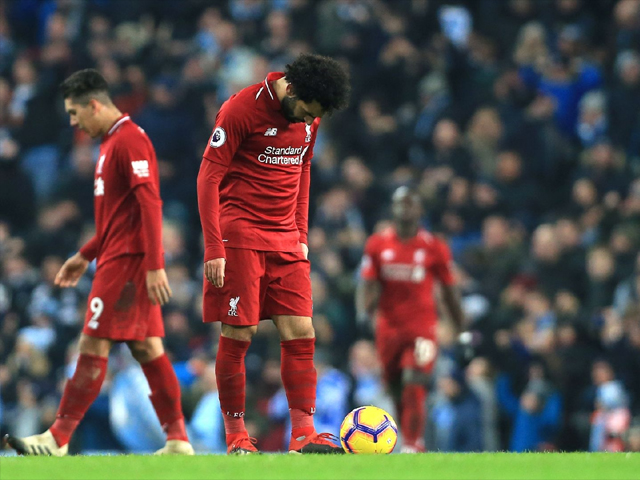 Mohamed Salah of Liverpool and his team look dejected during the Premier League match between Manchester City and Liverpool FC at the Etihad Stadium on January 3, 2019 in Manchester, United Kingdom. PHOTO: GETTY