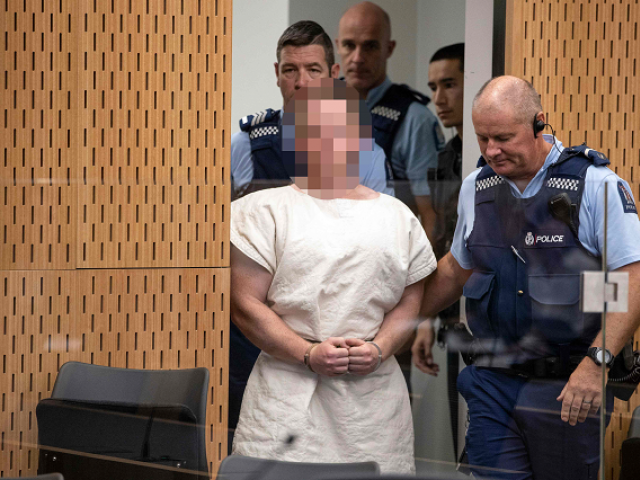 Brenton Tarrant , the man charged in relation to the Christchurch massacre, is lead into the dock for his appearance in the Christchurch District Court. PHOTO: AFP