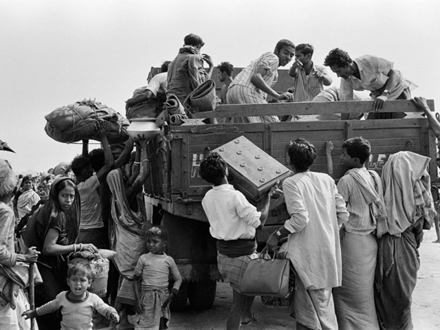 in this photo taken on february 1 1972 bengali refugees try to board a truck to return to their country after the indo pakistani war of 1971 in kolkata photo afp