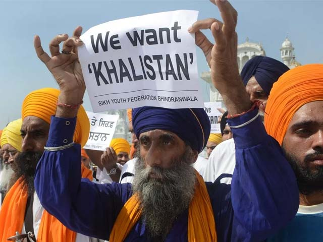 sikh organisations hold placards in support of khalistan photo afp