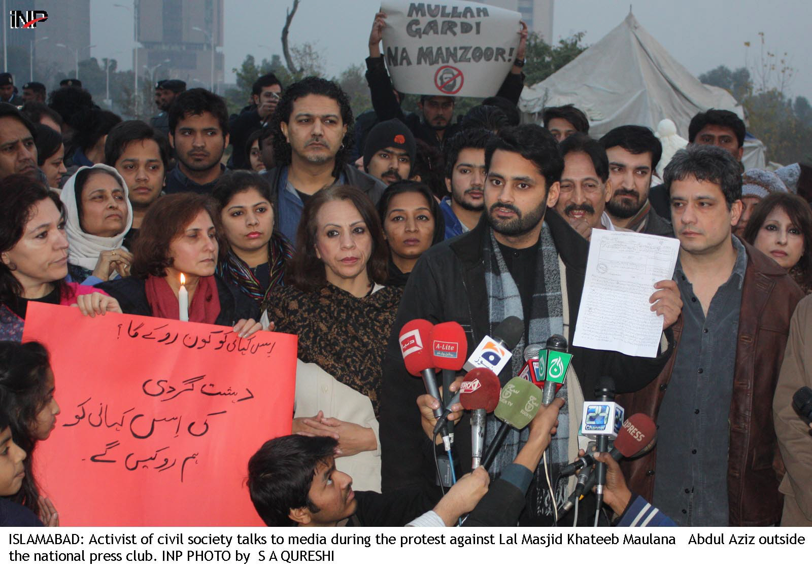 civil society activists led by m jibran nasir staged a protest against maulana abdul aziz photo inp