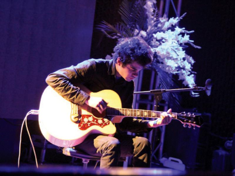 usman riaz gives a short performance at aku on thursday evening photo aysha saleem express