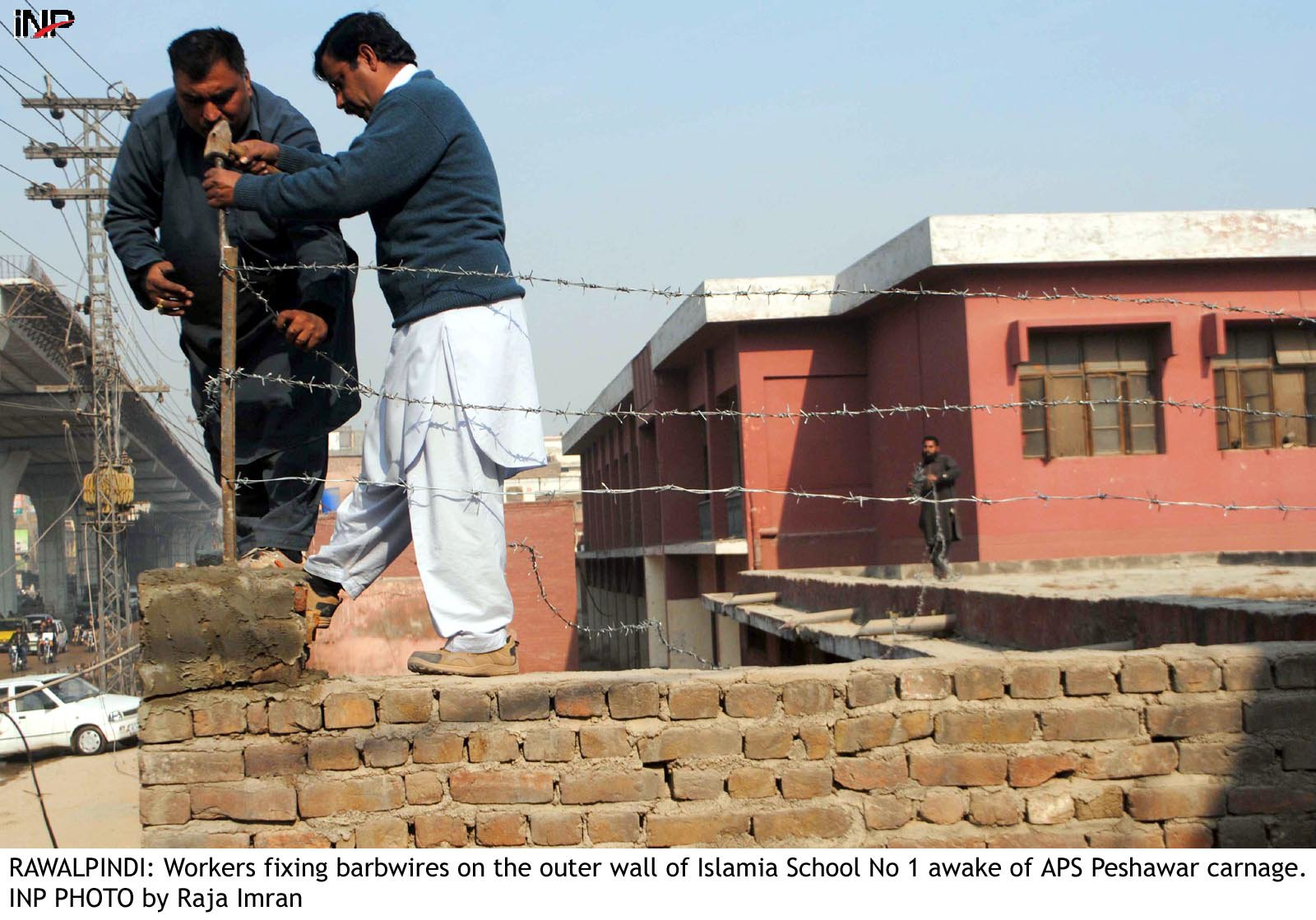 Boundary walls of schools and colleges are being raised to eight feet and being fortified with barbed wire. PHOTO: INP