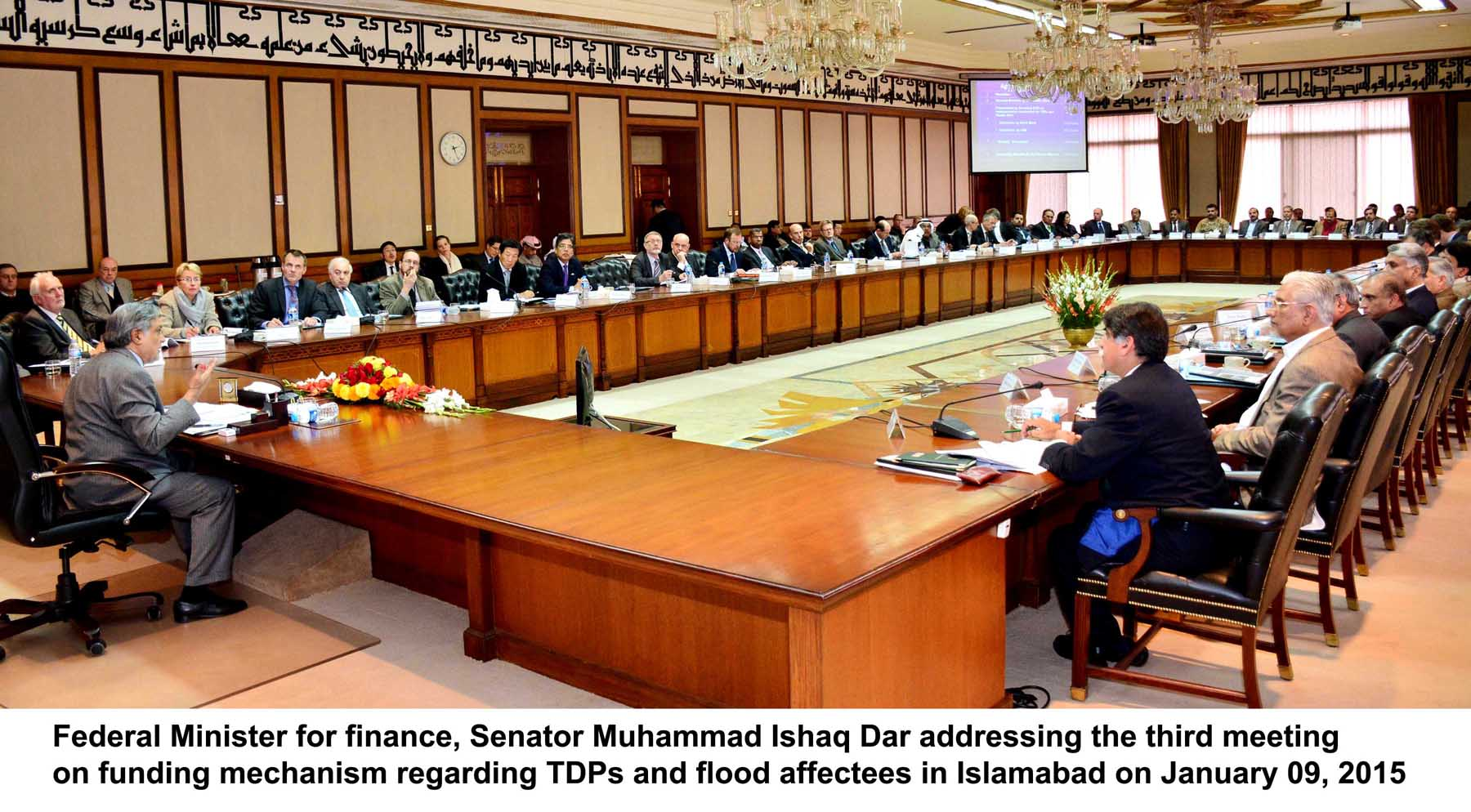 finance minister ishaq dar l addressing the donors conference at the pm house on friday photo pid
