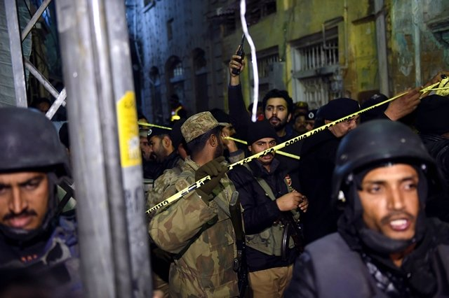 Pakistani security forces secure the site of a blast in Rawalpindi on January 9, 2015. PHOTO: AFP