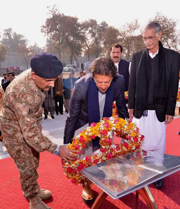 pti chief imran khan lays a wreath while visiting peshawar photo pti twitter