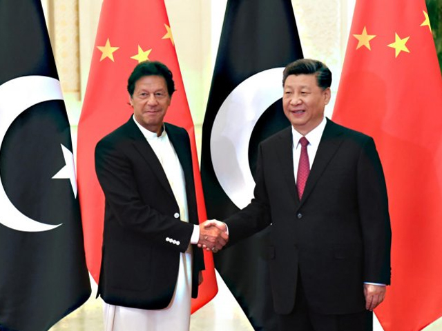 Prime Minister Imran Khan shakes hands with President Xi Jinping in Beijing before a meeting at the Great Hall of the People. PHOTO: REUTERS