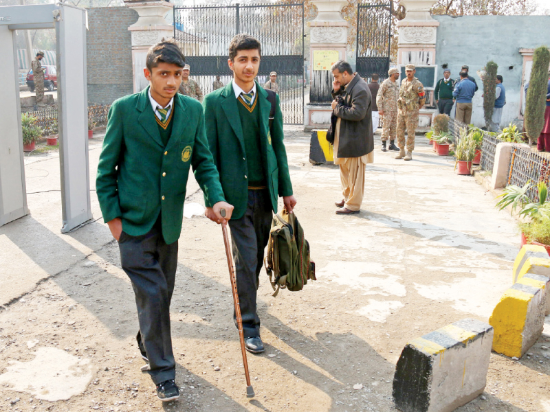 injured aps student leaves after day in class photo muhammad iqbal
