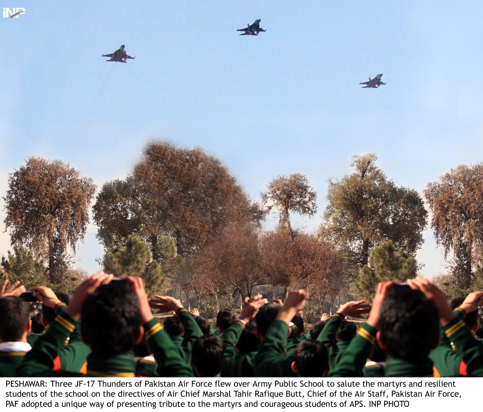 kids punch the air as paf 039 s jf 17 fighter jets fly over their school on friday photo inp