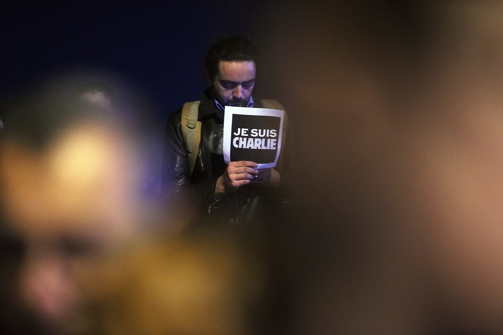 a man holds a placard reading quot i am charlie quot during a gathering at the old harbor in marseille on january 7 2015 following an attack by unknown gunmen on the offices of the satirical weekly charlie hebdo photo afp