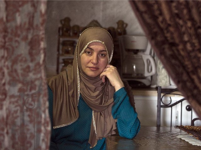 Rania El-Alloul in her neighbour's home in Montreal's West Island suburb of Dollard-des-Ormeaux, Quebec, Feb. 27, 2015. PHOTO: CHRISTINNE MUSCHI/THE GLOBE AND MAIL