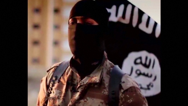 a masked man speaking is shown in a video released by is militants in september 2014 photo reuters
