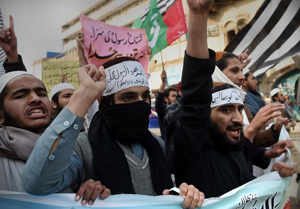 activists from different pakistani religious parties shout slogans against the printing of satirical sketches of the prophet mohammed by french magazine charlie hebdo in peshawar photo afp