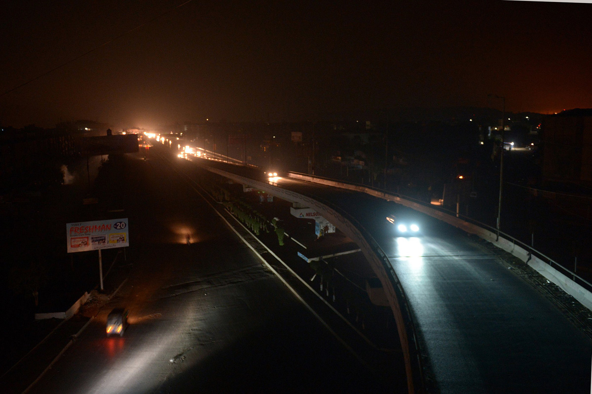 motorists drive on an unlit street during a power cut in karachi on january 25 2015 photo afp