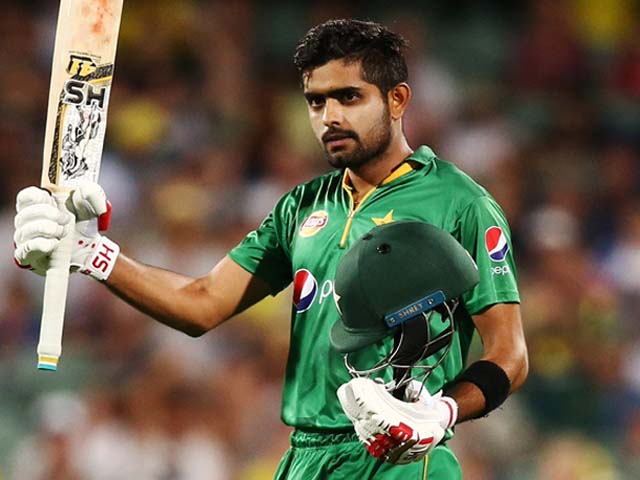 Babar Azam celebrates after reaching 100 runs during a game between Australia and Pakistan. PHOTO: GETTY