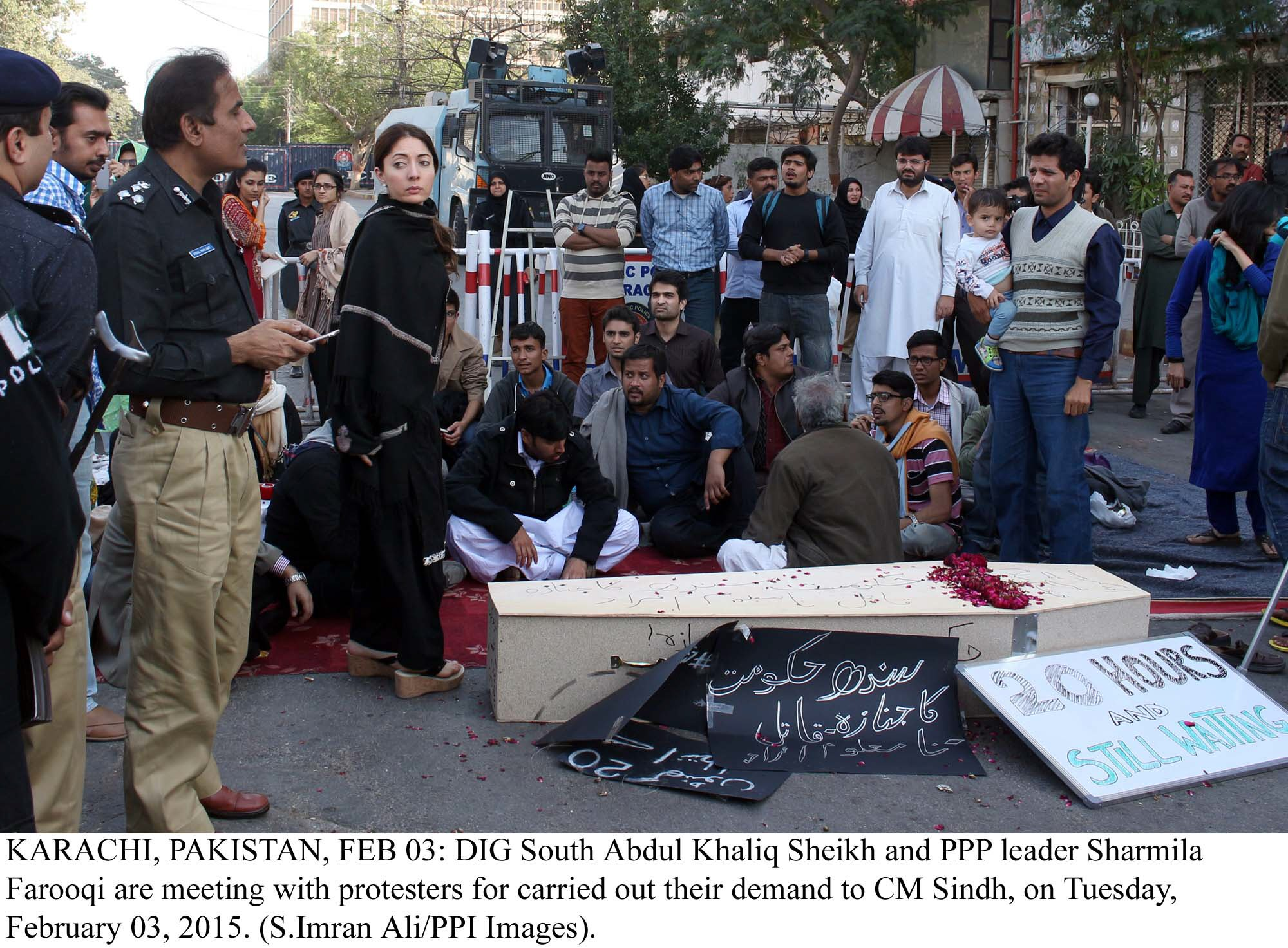 dig khalique shaikh and ppp leader sharmila farooqi negotiating with protesters outside cm house in karachi photo ppi