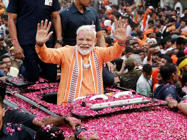 PM Narendra Modi at a mega roadshow in Varanasi, joined by thousands of supporters, party workers, and locals. PHOTO: REUTERS