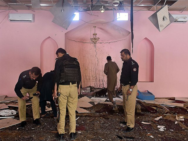 pakistani police officials examine the interior of a mosque after a blast on the outskirts of quetta on may 24 2019 photo afp