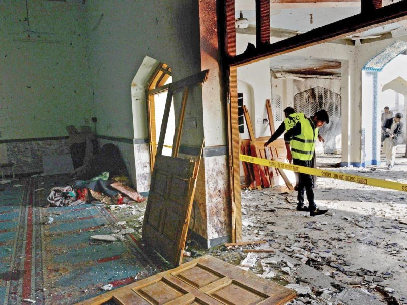 rescuers remove wreckage from imamia masjid a day after it was attacked by terrorists photo afp