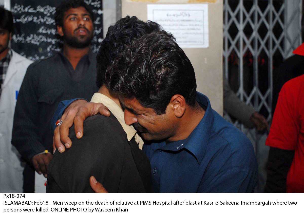 relatives of the victims comfort each other at pims hospital in islamabad photo online