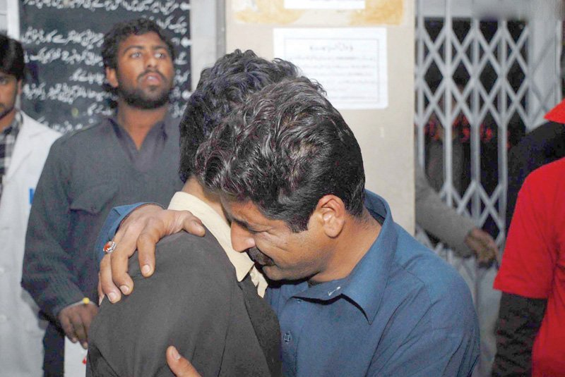 men weep at the death of their relative in the blast at the qasr e sakina imambargah photo online