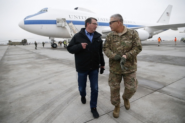 US Secretary of Defense Ashton Carter (L) walks with US Army General John Campbell, who greeted him upon his arrival at Hamid Karzai International Airport in Kabul . PHOTO: AFP