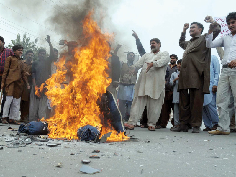 Angry cricket fans burn an effigy representing the PCB chairman in Multan. PHOTO: PPI