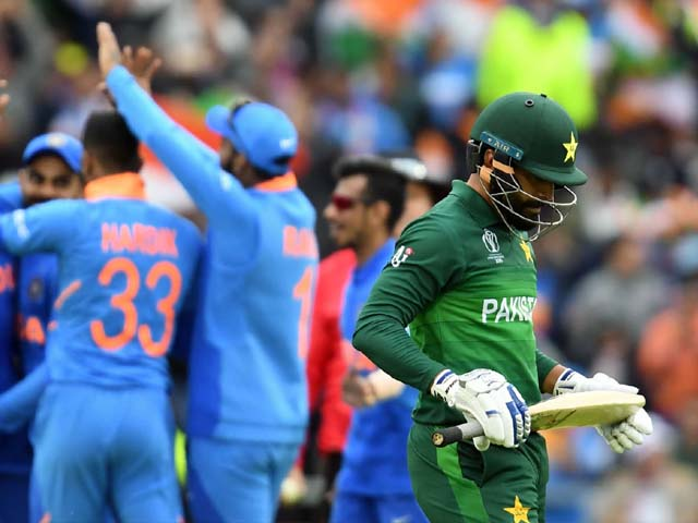 Mohammad Hafeez walks back to the pavilion after his dismissal. PHOTO: GETTY