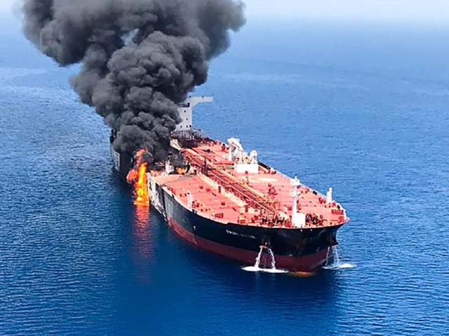 Fire and smoke billowing from a tanker said to have been attacked in the Gulf of Oman. PHOTO: GETTY