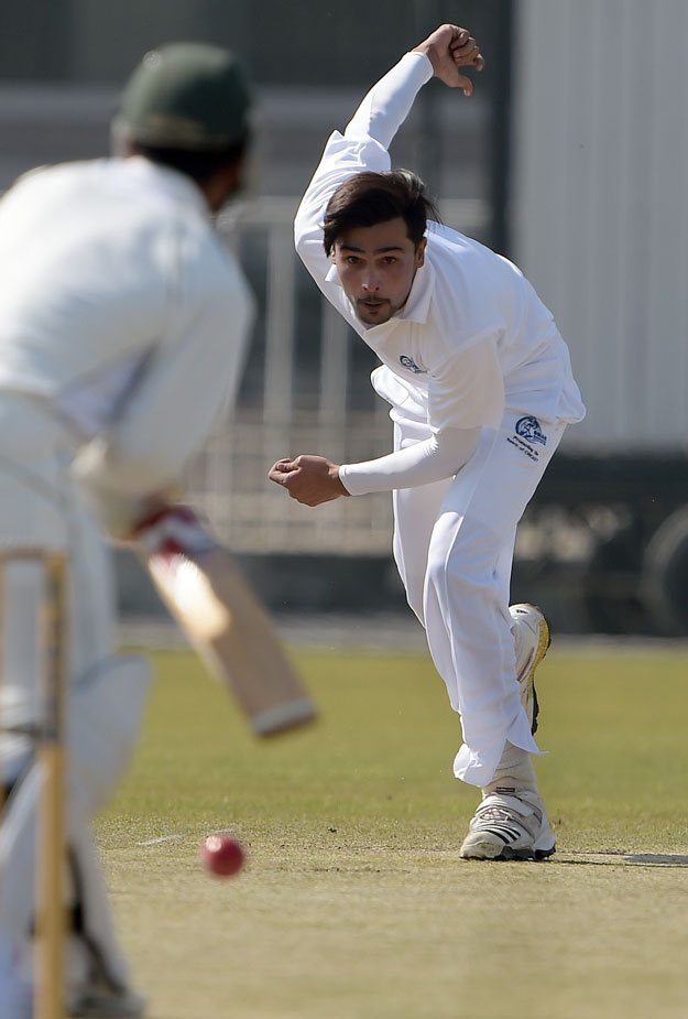 Pacer Mohammad Amir bowls during a three day match at the Pindi Cricket Stadium in Rawalpindi on March 13, 2015. PHOTO: AFP