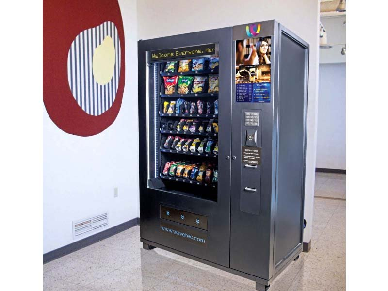 nfc enables users to wave over their smartphones or tap their plastic cards to an nfc enabled vending machine which then dispenses the item selected by the user photo wavetec