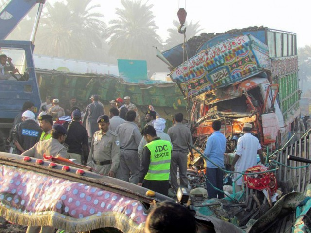 head on collision between passenger coach and truck also leaves 20 injured photo afp