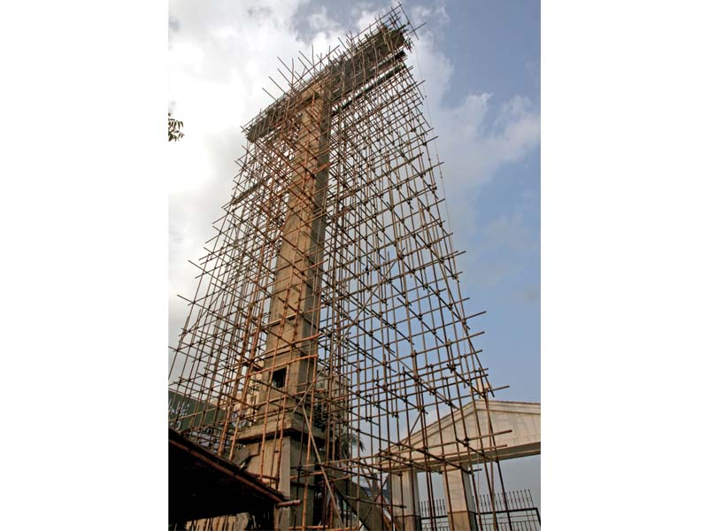 the henry gill family is financing the construction of a 140 foot tall cross in one of the cities oldest christian cemeteries photo athar khan express