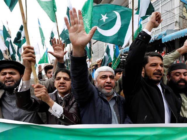 People raise their hands as they chant slogans to show solidarity with Pakistan Armed Forces at a rally in Peshawar. PHOTO: REUTERS
