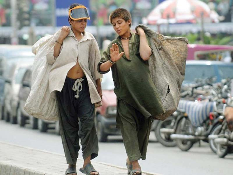 Two young boys collect garbage in the city. The waste generated by the metropolis is one of the biggest challenges facing its administration, but the UNDP may have a solution. PHOTO: FILE