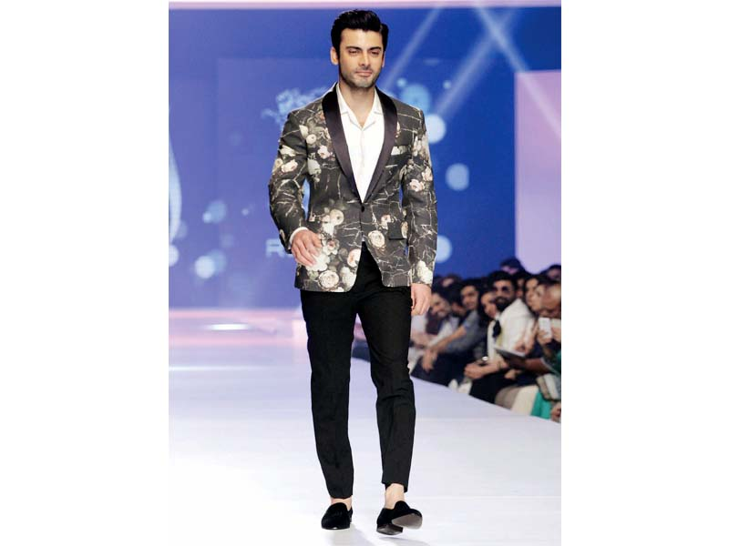 Showcase boasts slick silhouettes and well-tailored ensembles by prominent designers. PHOTO: SHAFIQ MALIK/EXPRESS & PUBLICITY / DESIGN: UMAR WAQAS
