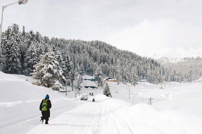 a kashmiri boy walks down a road in gulmarg known to be a world class skiing destination photos haziq qadri