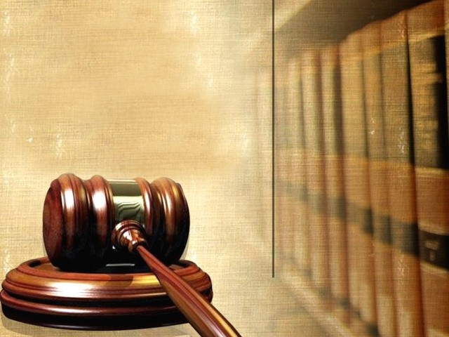 judge says judicial inquiry is already underway no action till report is submitted stock image