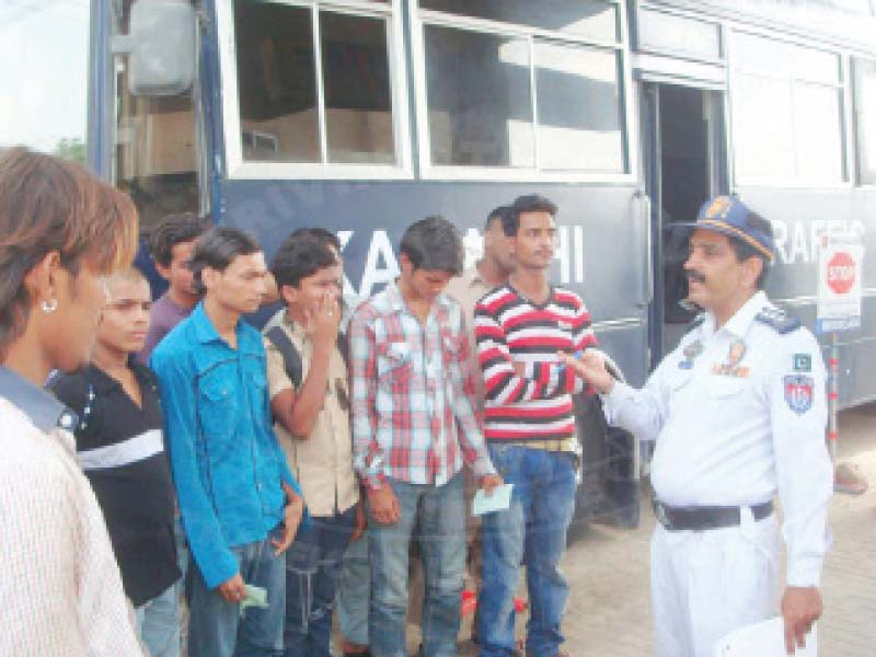a traffic police officer speaks to underage drivers after their vehicles were impounded by the dept the police have initiated a campaign against underage drivers photo courtesy rahnuma traffic police facebook page