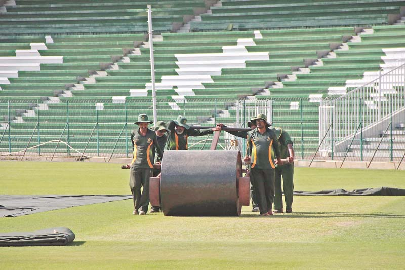 Preparations for the arrival of Zimbabwe resumed after a temporary break. PHOTO: SHAFIQ MALIK/EXPRESS