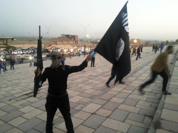 The militants seized the government complex at around 2:00 pm and raised the black flag PHOTO: REUTERS