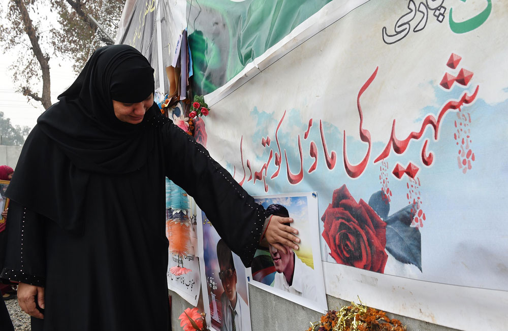 a mother of a schoolchild killed in a taliban attack on the army public school aps reacts during a protest against delays in the investigation in peshawar on february 7 2015 photo afp