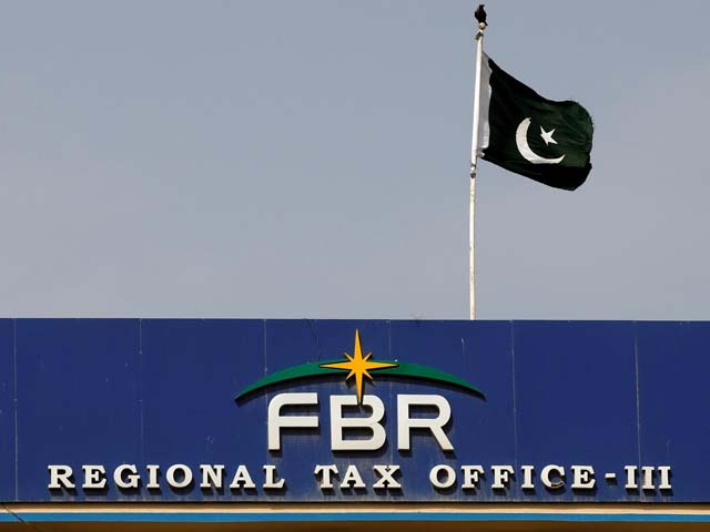 The national flag is seen on the Federal Board of Revenue (FBR) office building in Karachi. PHOTO: REUTERS