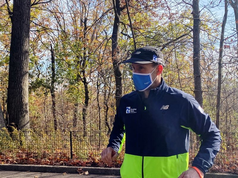 thomas panek a blind runner and ceo of guiding eyes for the blind gets ready for a 5k run in central park where he will use google s guideline app instead of help from a human or guide dog in new york us november 19 2020 photo reuters