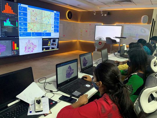 software professionals assisting municipal authorities work on their terminals inside a war room focused on tracking the spread of the coronavirus disease covid 19 at the bruhat bengaluru mahanagara palike office in bengaluru india july 2 2020 photo reuters