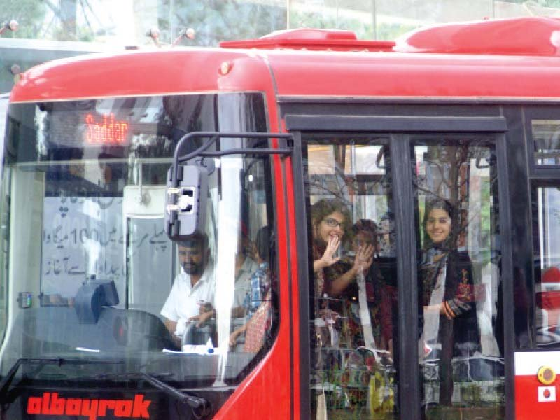 students taking their first ride on the metro bus in islamabad photo inp